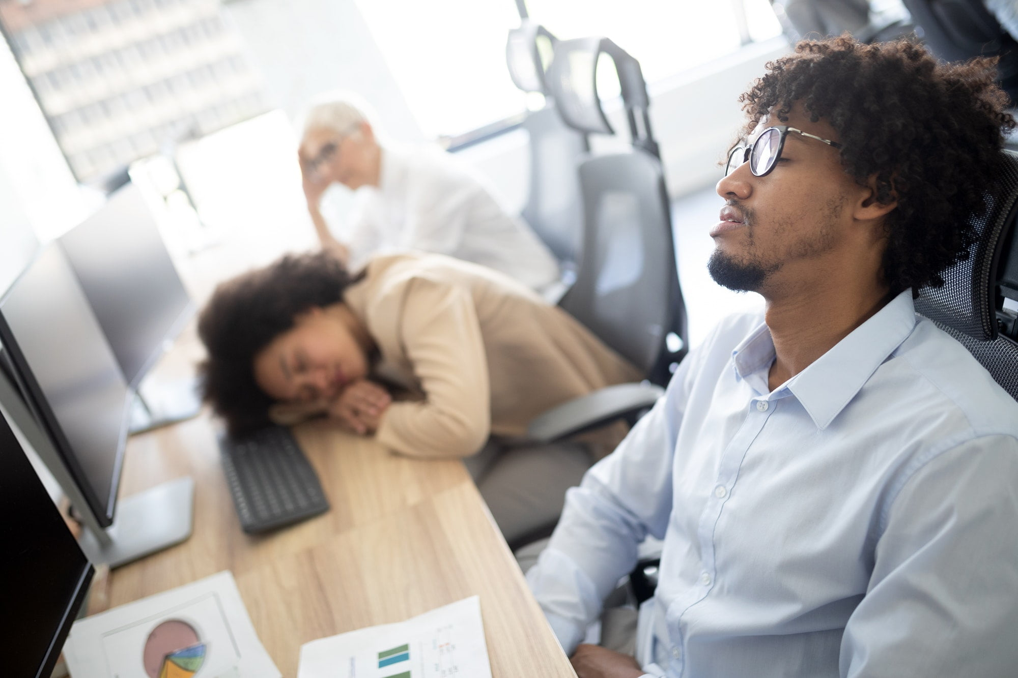 Overworking concept. Group of business people exhausted in office
